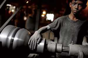 A boy working in a factory