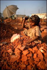 A girl breaking bricks for a living