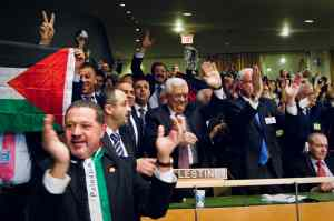 Members of the Palestinian delegation to the UN cheer the results of a vote granting Palestine non-voting observer status on November 29, 2012. UN Photo/Rick Bajornas